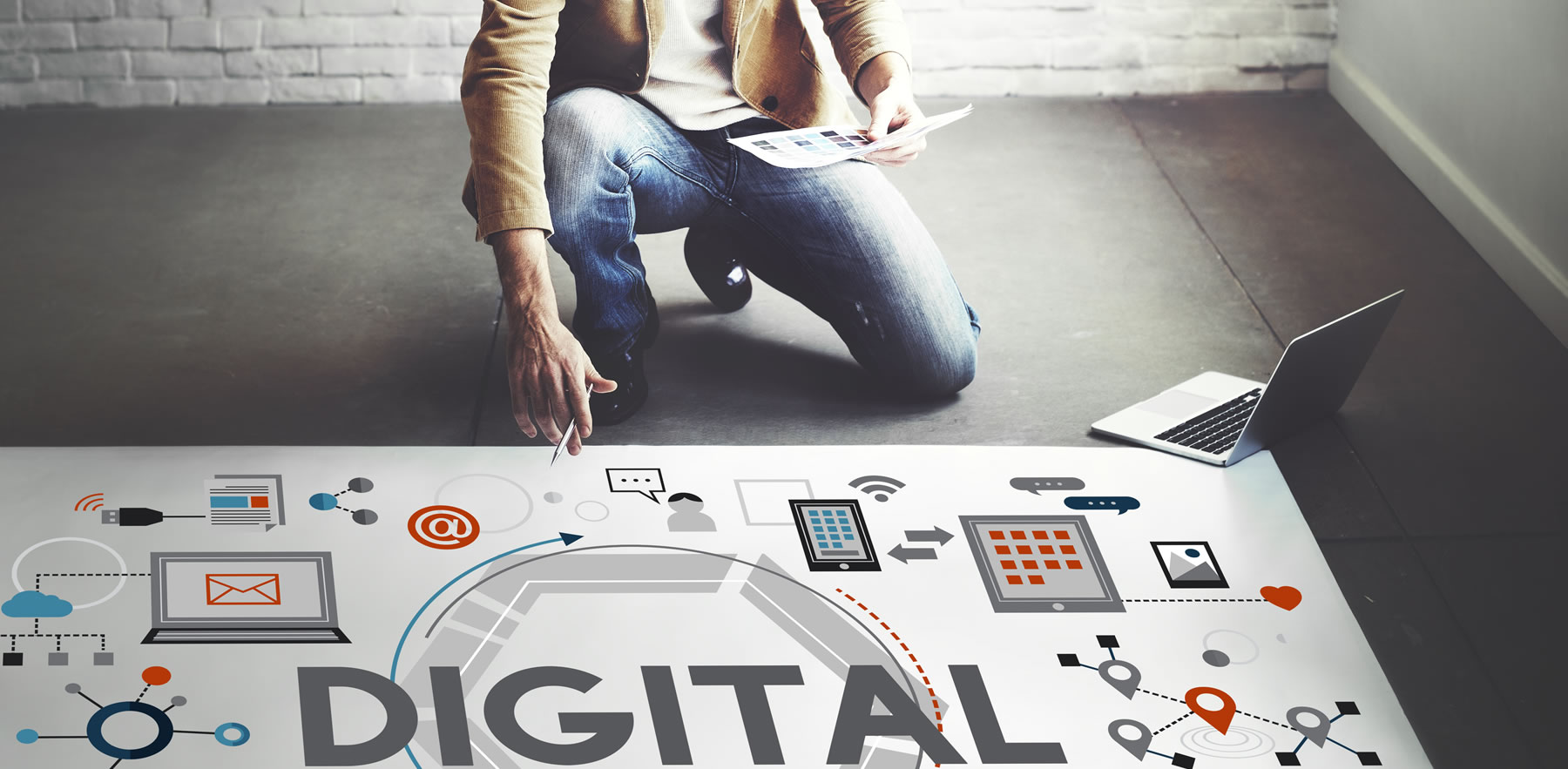 Man kneeling and looking at digital marketing strategy graphic - Marketing