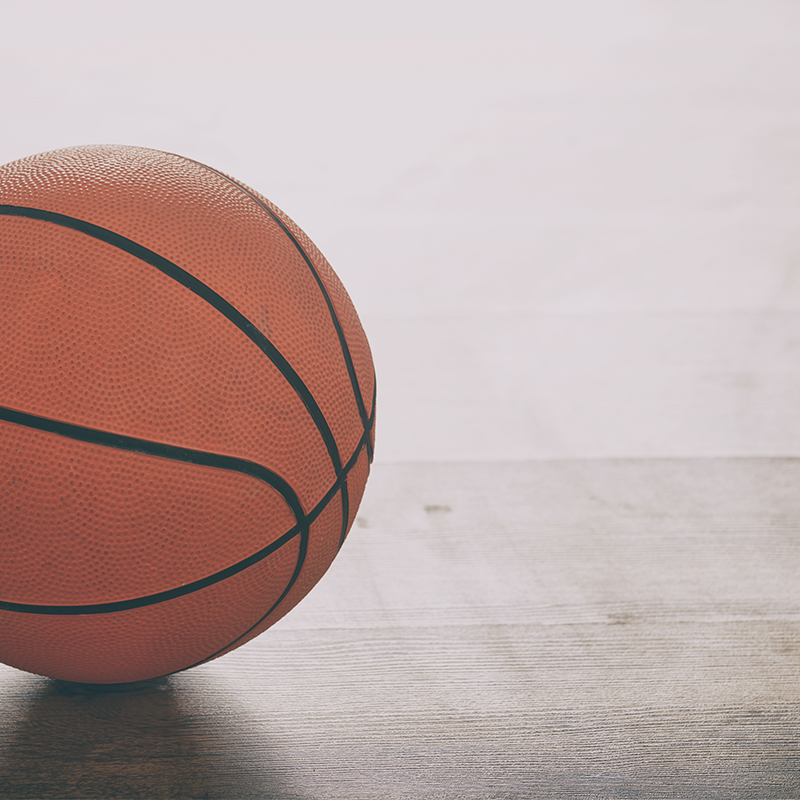 Basketball sitting on the floor - Intercollegiate Sport Insurance