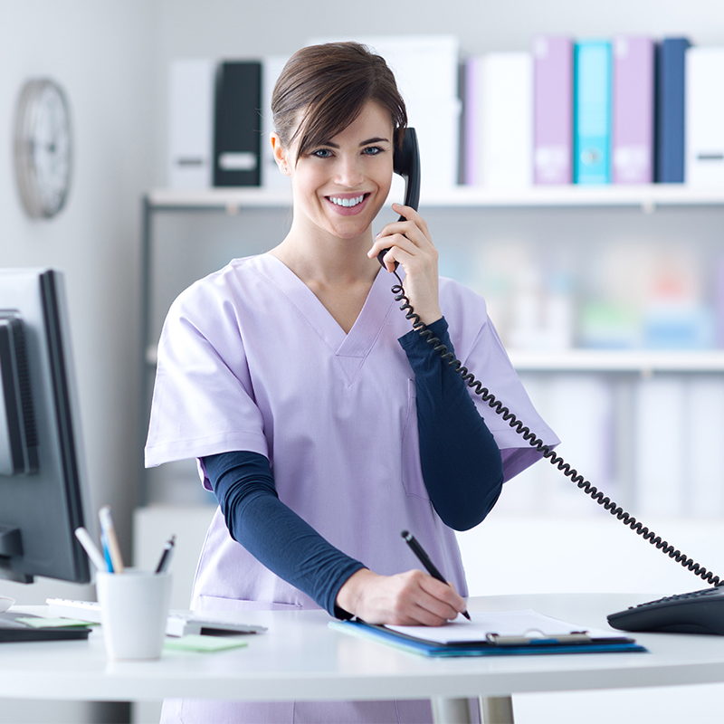 Smiling nurse on phone - 24-hour nurseline